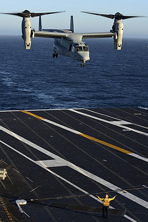 Carrier onboard delivery - An MV-22 Osprey of Marine Medium Tiltrotor Squadron (VMM) 165 prepares to land on the flight deck of the aircraft carrier USS Nimitz (CVN 68) during testing. The V-22 has been selected for COD missions.