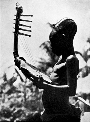 Sub-Saharan African music traditions - A Mangbetu man playing an African harp