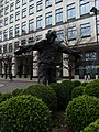 Man With Open Arms by Giles Penny, West India Avenue - view from behind in March 2011.jpg
