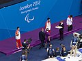Medal ceremony - Swimming at the 2012 Summer Paralympics – Men's 100 metre backstroke S6 - Cropped.jpg
