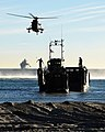 Members of Charlie Company 40 Commando and 4 Assault Squadron Royal Marines (ASRM) go ashore aboard a Landing Craft Utility (carrying a Viking Armoured Vehicle). MOD 45158416.jpg