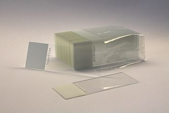 Microscope slide - A set of standard 75 by 25 mm microscope slides. The white area can be written on to label the slide.