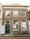foto van Eenvoudig woonhuis met in baksteen opgetrokken achterhuis