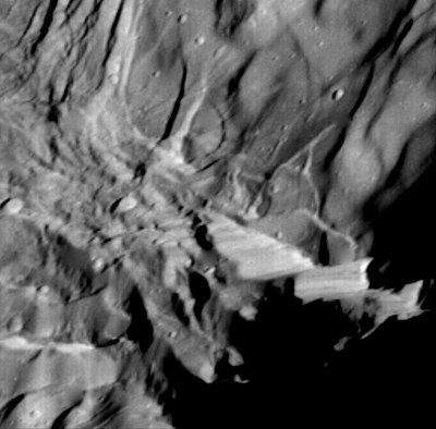 Close-up of Verona Rupes, a large fault scarp on Miranda possibly 20 km (12 mi) high, taken by Voyager 2 in January 1986 Miranda scarp.jpg