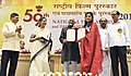 Mohd. Hamid Ansari presenting the Rajat Kamal Award to Ms. Roopa Ganguly for the Best Female Playback Singer, at the 59th National Film Awards function, in New Delhi. The Union Minister for Information and Broadcasting.jpg