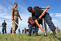 Mongolian police Sgt. B. Tulga, right, and Junior Sgt. P. Khatanbat demonstrate baton techniques to U.S. Marine Corps Cpl. Ivan Vargas-Rosales, left, an assistant nonlethal weapons instructor with the 3rd Law 130819-M-MG222-003.jpg