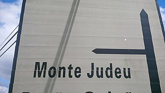 History of the Jews in Portugal - A road sign indicating a small Village in the Algarve called 'Monte Judeu', (in English 'Jewish Mount'), influenced by the Jews who lived in the region.