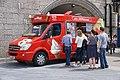 Mr Whippy ice cream van with customers (side).jpg