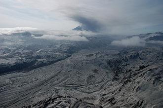 2009 Mount Redoubt eruptive activity - Mount Redoubt on March 31, 2009. An ash cloud is hanging over the summit and the valley is covered in volcanic ash.