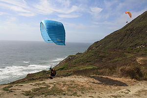 Mussel Rock - A pair of paragliders take flight at Mussel Rock Beach near Daly City, California.