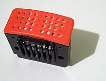 A rectangular cartridge consisting of a black base and a flat, red top