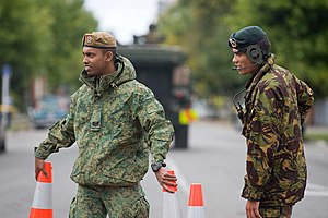 Singapore Guards - A Guardsman and a member of the New Zealand Defence Force man a cordon around the CBD in the aftermath of the February 2011 Christchurch earthquake.