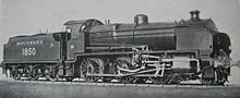 Official side view of a 2-6-0 locomotive against a white background. The distinguishing feature from normal N class locomotives is the experimental motion that powers the wheels.