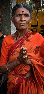 Woman performing namaste gesture.