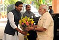 Narendra Modi being welcomed by the Minister of State for Information & Broadcasting, Col. Rajyavardhan Singh Rathore on his arrival at the launching ceremony of DD Kisan Channel, in New Delhi on May 26, 2015.jpg