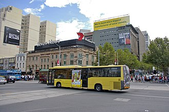 National Bus Company (Australia) - Custom Coaches bodied MAN 15.220 outside Flinders Street station in February 2008