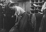 Night-Mail 1936 GPO documentary preparing mail bag for drop.jpg