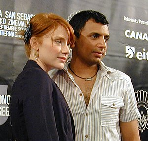 M. Night Shyamalan - M. Night Shyamalan and Bryce Dallas Howard at the Spanish premiere of The Village (in the San Sebastián International Film Festival, 2006).
