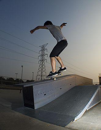 Grind (skateboarding) - A skateboarder performing a nosegrind