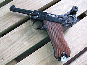 Luger pistol - A P-08, BYF-41, 1941, 9×19mm caliber Parabellum Luger Mauser pistol—with the safety on, and with breech opened, showing the jointed arm in its most bent and locked position