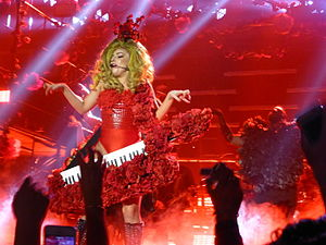 "Lady Gaga Live at Roseland Ballroom - Gaga and her dancer holding the rose adorned keytar during the performance of ""Monster"""