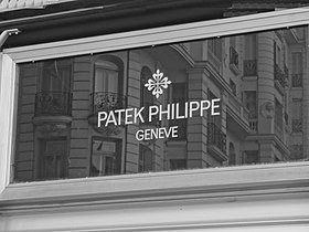 Patek Philippe & Co. sign on Gran Via in Madrid, photographed in black and white.JPG