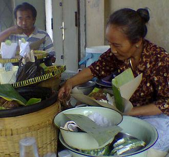 Gudeg - A street stall of a woman selling gudeg.