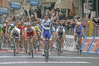 Milan–San Remo - Italian Sprinter Alessandro Petacchi winning the 2005 Milan–San Remo in a group sprint on the Via Roma.