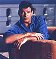 Pierce Brosnan sitting in Pacific Green sofa.jpg