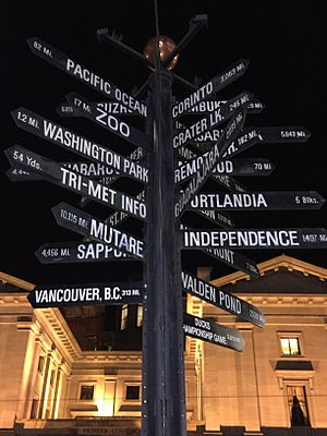 Pioneer Courthouse Square - The milepost sign at the square at night