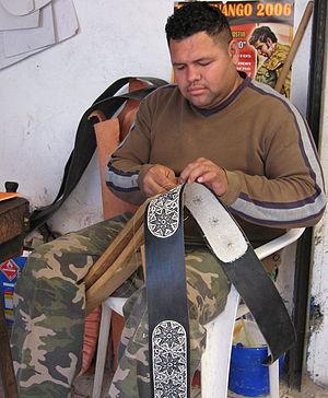 Piteado - Punteador at work in talabartería