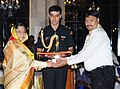 Pratibha Devisingh Patil presenting the Thanks Badge Award 2010-11 to Shri Guru Parshad Sanghi, Volunteer the Bharat Scouts and Guides, Andhra Pradesh.jpg