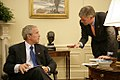 President George W. Bush confers with White House Press Secretary Tony Snow.jpg