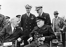 President Roosevelt and Winston Churchill seated on the quarterdeck of HMS PRINCE OF WALES for a Sunday service during the Atlantic Conference, 10 August 1941. A4816.jpg
