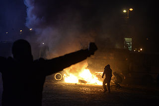 Radically oriented protesters throwing Molotov cocktails in direction of Interior troops positions. Dynamivska str. Euromaidan Protests. Events of Jan 19, 2014-2.jpg