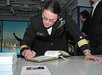 Rear Adm. Cynthia M. Thebaud, commander Expeditionary Strike Group 2, signs the guest book at the National Sept. 11 Memorial and Museum 151109-N-RE886-330.jpg