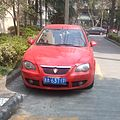 Red car China with lion logo 2017.jpg