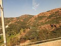 Red rocks of the Esterel seen from the train.jpg