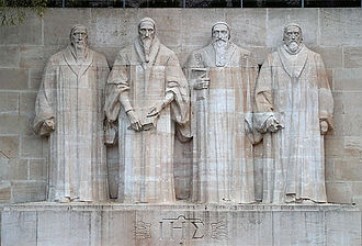 Reformation Wall - At the centre of the Wall are statues to William Farel, John Calvin, Theodore Beza, and John Knox.  The Christogram can be seen below the statues.