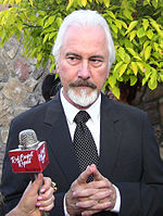 Photo of Rick Baker being interviewed at the Saturn Awards in 2011.
