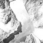Riggs Glacier, tidewater glacier terminus, glacial remnents and iceberg choked water, August 22, 1965 (GLACIERS 5851).jpg