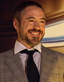 Robert Downey Jr. smiling and facing left in 2008