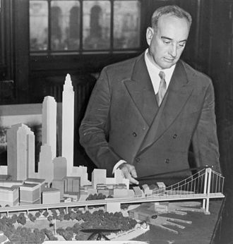 Robert Moses - Robert Moses with a model of his proposed Battery Bridge