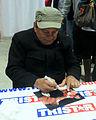 Roberto Duran signing autographs in Jan 2014.jpg