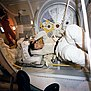 STS-2 Engle doffing-donning EMU.jpg