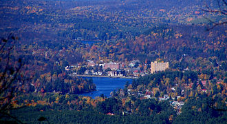 Saranac Lake, New York - The village of Saranac Lake, with Lake Flower below and Lake Colby above, from Scarface Mountain to the Southeast.