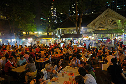 Lau Pa Sat hawker centre in the financial district. Satay cart-stalls roll in after dusk, on a side street.