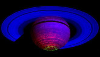 Magnetosphere of Saturn - False-colour composite image showing the glow of auroras streaking out about 1,000 kilometres from the cloud tops of Saturn's south polar region