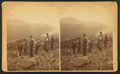 Scene on Bald Mountain(?) (Men on a mountain wearing packs, one holding a small dog.), by E. R. Starbird.png