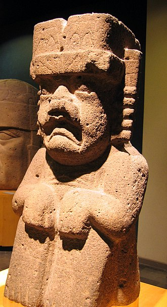 Olmec religion - Monument 52 from San Lorenzo Tenochtitlán. Some researchers identify this figure as the were-jaguar while others state that it instead represents the Rain Deity. The long deep groove carved into the back of this basalt sculpture indicates it was part of the drainage system.
